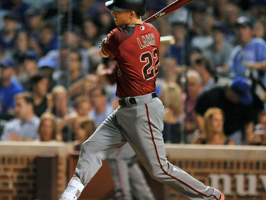 Arizona Diamondbacks' Jake Lamb watches his two RBI double during the sixth inning of a baseball game against the Chicago Cubs Wednesday, Aug. 2, 2017, in Chicago. (AP Photo/Paul Beaty)