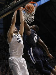 Butler Bulldogs center Nate Fowler (51) slams the ball down over Villanova Wildcats forward Eric Paschall (4) in the second half of their game at Hinkle Fieldhouse Saturday, Dec. 30, 2017. The Butler Bulldogs defeated the Villanova Wildcats 101-93.