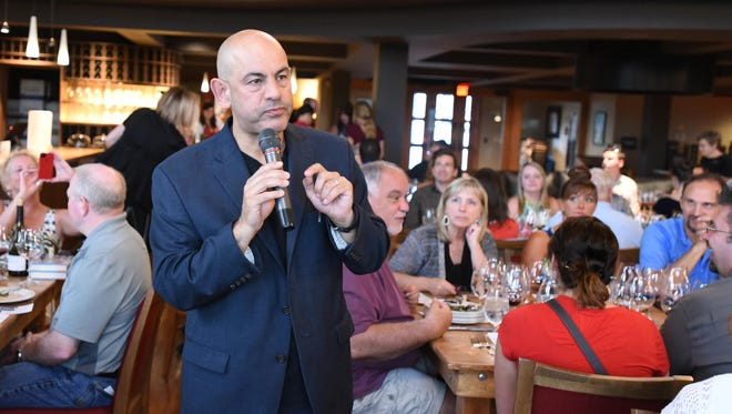 Food Network Star Simon Majumdar shares a story with guests during the Chef Cook-Off on June 23 at Willamette Valley Vineyards in Turner.