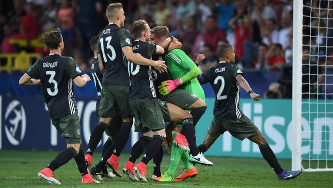 Germany players celebrate the win.