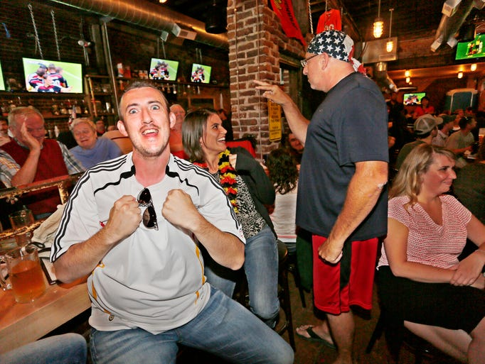 Klaus Schmidt reacts as Germany scores in the second against the US in the World Cup Thursday, June 26, 2014, at DT Kirby's, 644 Main Street in Lafayette. Schmidt, who is from Germany, and a small contingent of Germans cheered as Germany defeated the US 1-0 and finished on top of Group G with seven points. The Americans still advanced to the round of 16, however, on goal difference over Portugal.