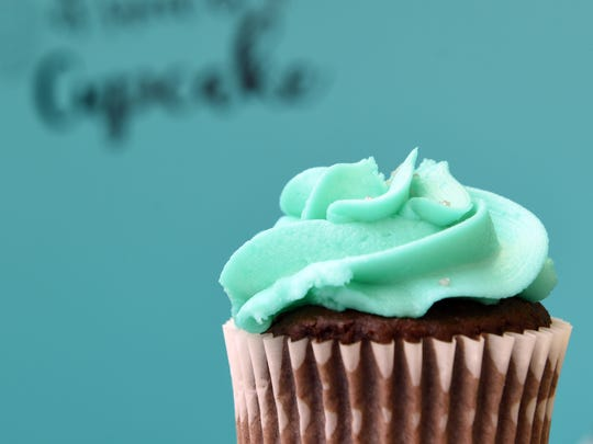 A cupcake by Simply Sweets by Heather in the bakery's signature color.