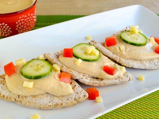 Open-Faced Garlic Hummus Pita Sandwich.