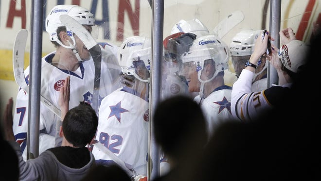Rochester's Chad Ruhwedel, right, is swarmed by teammates after his second goal of the game Wednesday in a 5-3 win over Hamilton.
