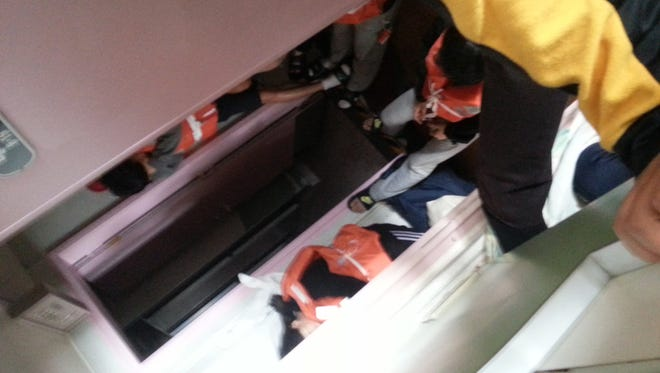 In a cellphone photo taken on April 16 by deceased South Korean high school student Park Su-hyeon and released by his father Park Jong-dae, students are shown inside the sinking ferry Sewol on waters near Jindo, South Korea.
