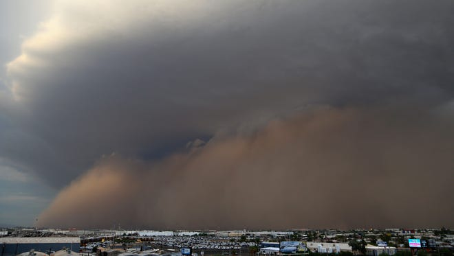 A dust storm approaches Phoenix before the MLB game between the San Diego Padres and the Arizona Diamondbacks on Monday.