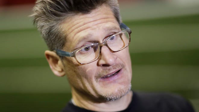 Atlanta Falcons general manager Thomas Dimitroff answering questions from the media at the NFL football team's practice facility in Flowery Branch, Ga.