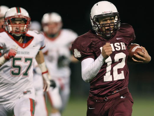 Jake Zembiec runs for a TD in a 48-34 Aquinas victory on Saturday.