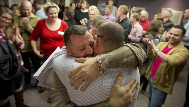 Chris Serrano, left, and Clifton Webb embrace after being married in Salt Lake City on Dec. 20, 2013.