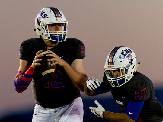 Campbell County's Zach Rutherford (12) looks to pass