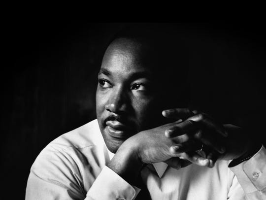 Martin Luther King Jr. listens at a meeting of the SCLC, the Southern Christian Leadership Conference, at a restaurant in Atlanta. The SCLC is a civil rights organization formed by Martin Luther King after the success of the Montgomery bus boycott.