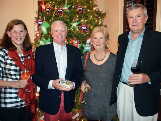 Laura and Bob Culnane, left, with Gene and Dick Bordeau at Grand HarborCommunity Outreach Evening of Giving on Nov 9.