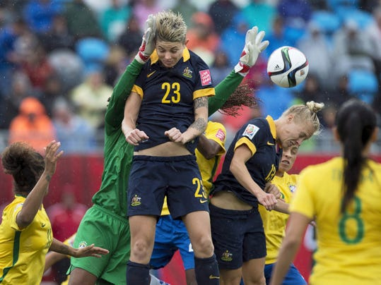 Australia's Michelle Heyman (23) and Tameka Butt (13) jump for a ball against Brazil during the second half of a FIFA Women's World Cup soccer game in Moncton, New Brunswick. Australia upset Brazil, 1-0, which was the first goal Brazil allowed all tournament.
