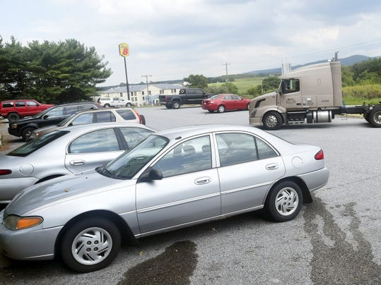 A truck pulls into the commuter lot at Exit 20 of Interstate 81 in Scotland on Monday.