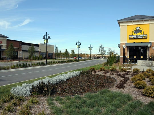 The entrance to the Shoppes at Fox River on Sunset Drive. The development includes Noodles and Buffalo Wild Wings restaurants, and continues to grow.