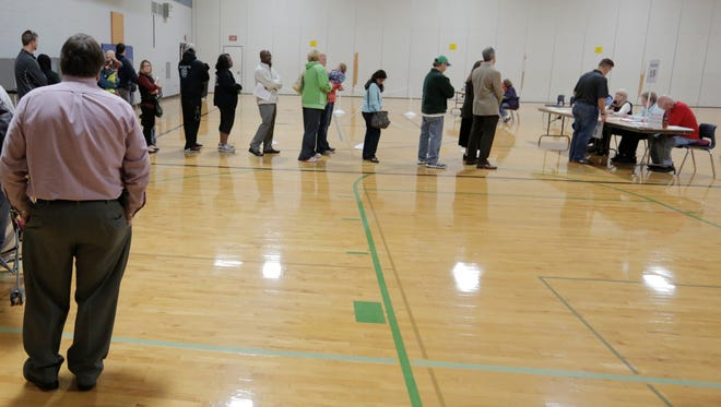 Oshkosh residents lined up to vote in Wards 19 and 20 Tuesday at Carl Traeger School in Oshkosh. When polls opened, the wait was about 40 minutes; after the morning rush cleared around 9 a.m., there was no waiting.