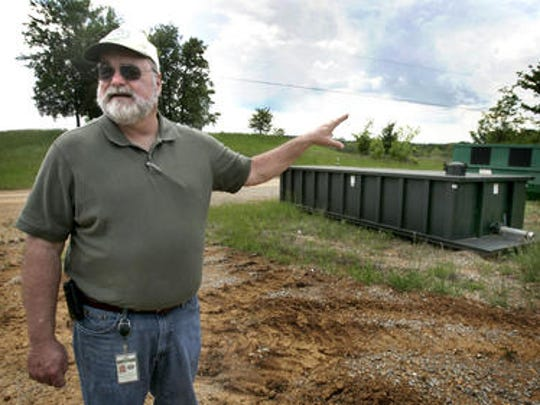 Mac Nolen, county solid waste director, points to the storage tank that holds leachate that is manually pumped from the ground at the Rutherford County landfill.