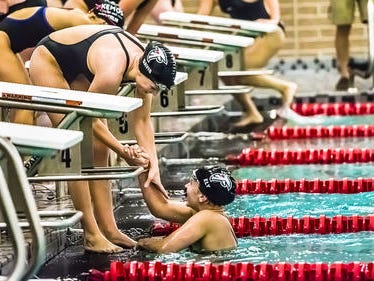 St. Johns' Rachel Ely (right) owns the top times in three events through this point in the girls swimming and diving season.