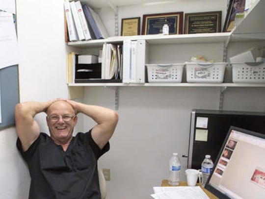Dr. Ken Snyder leans back in his desk chair in his
