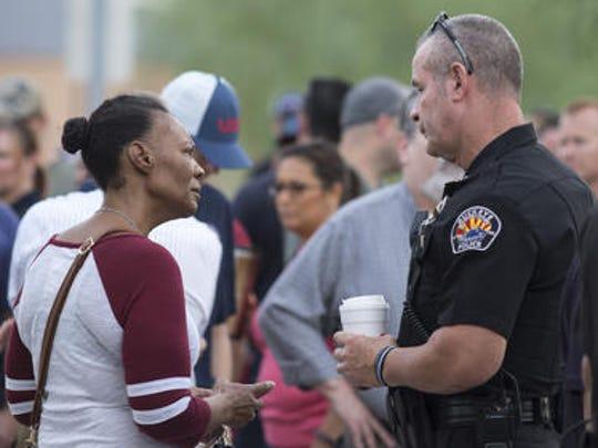 Buckeye Assistant Police Chief Mark Mann talks with