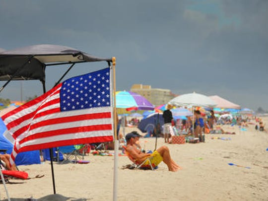 Brevard celebrated the Fourth of July on Wednesday, keeping on eye on ominous clouds to the west. At Tables Beach at Patrick Air Force Base, the beach was lined with beach-goers taking advantage of the weather.
