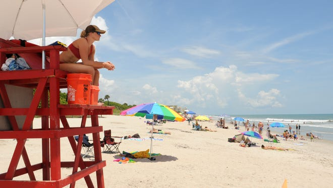 Brevard County lifeguard Ashley Nolan at Howard E. Futch Memorial Park at Paradise Beach, on the beachside area of Melbourne in July 2014.