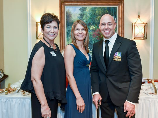 """Susan de Cuba, left, with Brianna Mast and Brian Mast. U.S. Rep.Mast contributed to the Little Treasures program by offering """"A Day with a Congressman"""" for the live auction."""