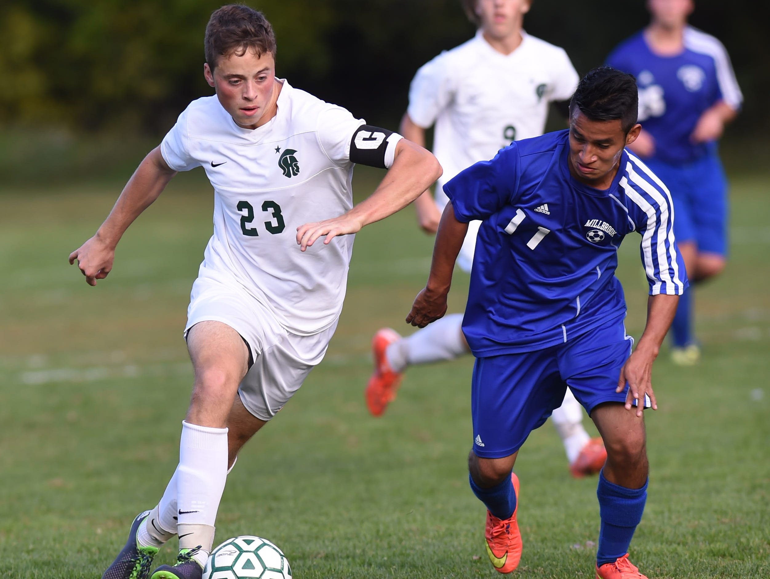 Spackenkill's Chris Stamper and Millbrook's Bryan Oliveros Martinez battle for the ball during Thursday's game in Poughkeepsie.