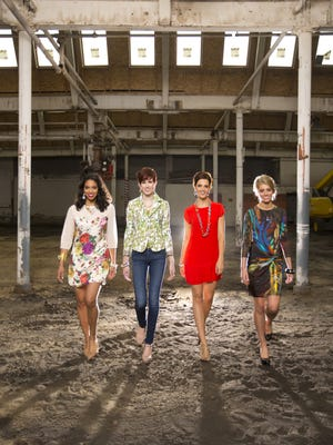 File photo 2013: Simone Boone, left, wife of Russell Street Factory developer Patrick Dutton, wears a Ted Baker Rose Bug dress from Red Barn Fine Apparel. Fashion Week models Nina Lutz, Kasey Cole and Nicole McFarland join her at the renovation site earlier this summer.