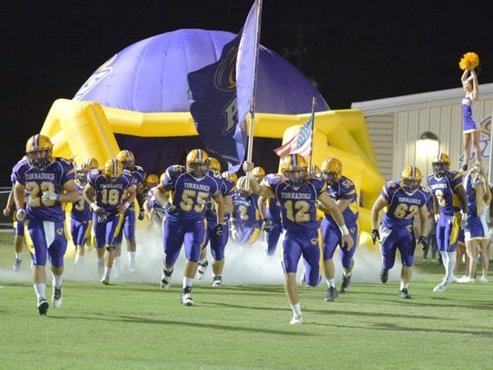 The Purvis football team takes the field before Friday's