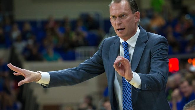Florida Gulf Coast University Men's Basketball Head Coach Joe Dooley talks to his players from the bench while playing Stetson on Saturday, Jan. 9, 2016, at Alico Arena in Fort Myers. (David Albers/Staff)