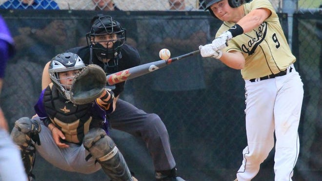 T.L. Hanna's Gaines Yates drives in teammate Tyler Kirkland near Northwestern catcher B.A. Ashley during the bottom of the second inning of class AAAA playoff action in Anderson. T.L. Hanna won 5-0.