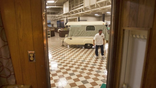 RICHARD QUINN/SPECIAL TO THE STAR Steven Pierce, car show coordinator for the Murphy Auto Museum, looks over campers that will be on exhibit for this year's Vintage Trailer Show, which runs form June 25 through Sept. 25.