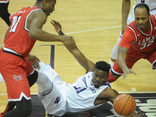 ACU's Jalone Friday, center, battles Lamar's Joey Frenchwood (32) and Josh Nzeakor for a loose ball. ACU beat the Cardinals 74-69 in the Southland Conference men's basketball game Wednesday, Jan. 31, 2018 at Moody Coliseum.
