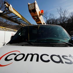 FILE - This Feb. 15, 2011 file photo, shows a Comcast logo on a Comcast installation truck in Pittsburgh. Comcast reports quarterly financial results on Thursday, Oct. 23, 2014. (AP Photo/Gene J. Puskar, File) ORG XMIT: NYBZ191