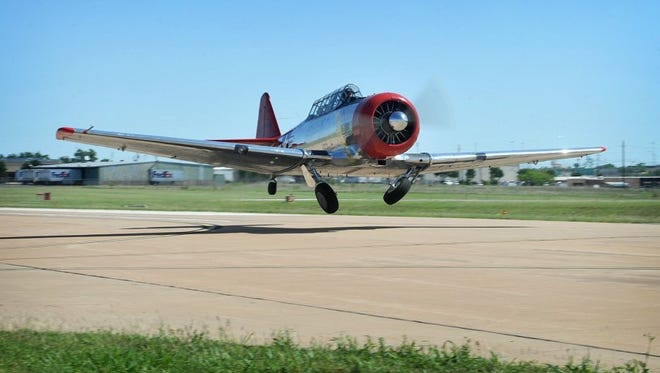 "The T-6 ""Texan"" trainer flown by pilot Chris Rounds."