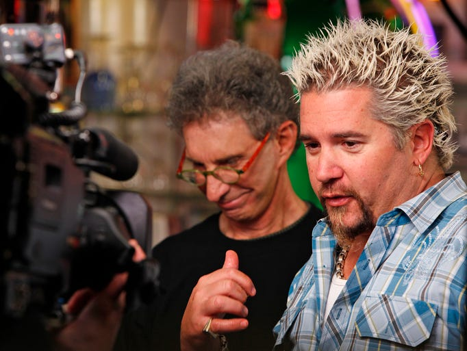 "Guy Fieri, host of The Food Network's ""Diners, Drive-ins and Dives,"" gives a ringing endorsement to owner Terry Carter's  burger at Terry's Turf Club in Linwood during a video shoot in March 2010."