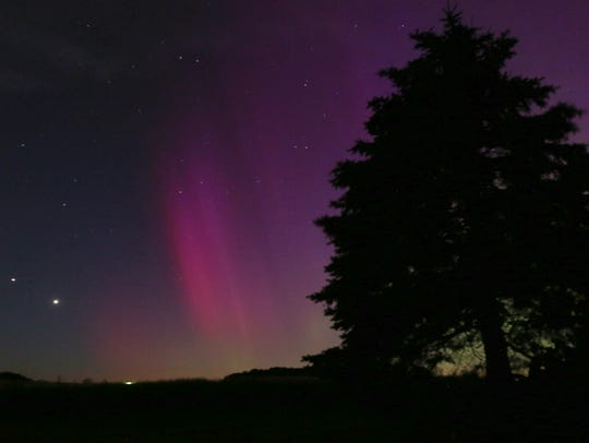The Northern Lights color the sky over Lansing, Iowa,