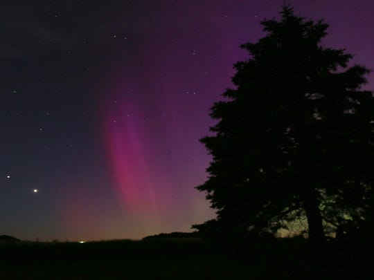 The Northern Lights color the sky over Lansing, Iowa, on Monday, June 22, 2015.