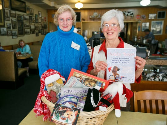 Lois Parker, left, and Kit Prohm, right, display examples of items that will be for sale at the Willamette Humane Society Thrift Store's Holiday Bazaar this Friday and Saturday.