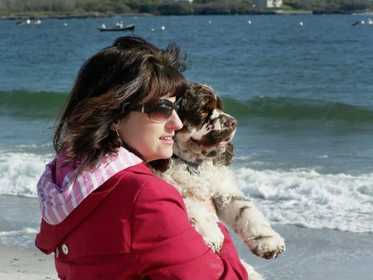 Carol Bryant, with dog Dexter at Cape Elizabeth, Maine, says she never forgets when businesses are friendly to dogs. Hotels ranging from major chains to small outposts are capitalizing on the wave of travelers who bring their dogs, some by charging for perks that pamper pets and others by expanding fees.