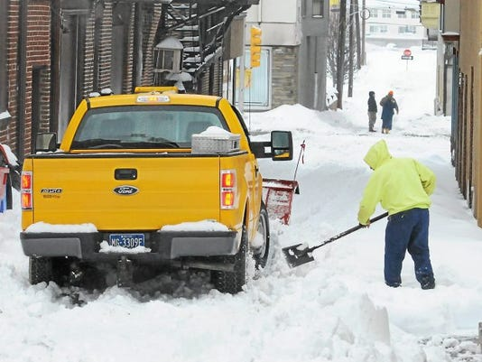Pottstown borough plow crew digs out after getting stuck on Penn Street which was covered in deep snow and no where for it to go.