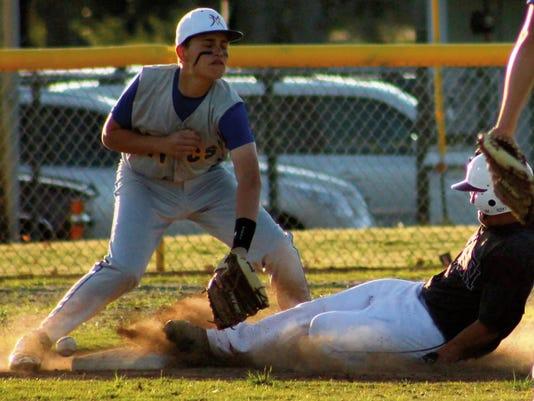Toby Carrillo slides into Josh Castillo Thursday evening at Apodaca Park.