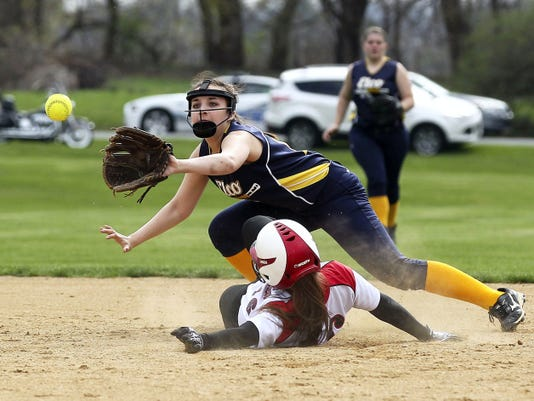 Annville-Cleona's Christy Snyder is safe at on a steal attempt as Elco shortstop Sarah Vermalovich applies the late tag.