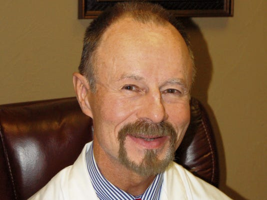 Dr. Michael Spence M.D.
