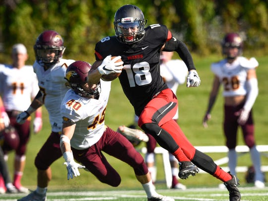 St. Cloud State wide receiver John Pass take goes in