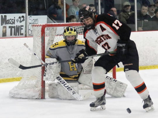 Brighton's Adam Conquest looks for the puck in front