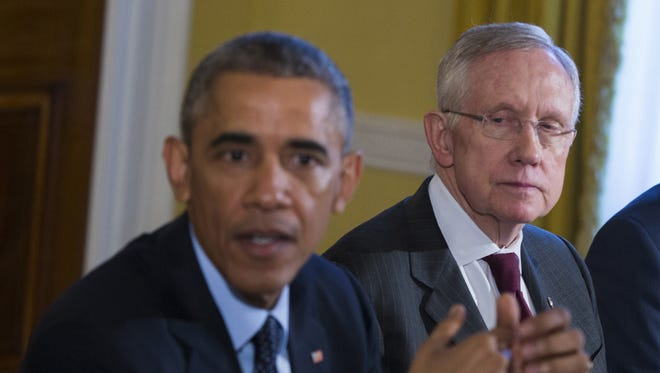 """In this Nov. 7, 2014 file photo, Senate Majority Leader Harry Reid of Nevada listens as PresidentObama speaks during a meeting with Congressional leaders in the Old Family Dining Room of the White House in Washington. Reid is announcing he will not seek re-election to another term. The 75-year-old Reid says in a statement issued by his office Friday that he wants to make sure Democrats regain control of the Senate next year and that it would be """"inappropriate"""" for him to soak up campaign resources when he could be focusing on putting the Democrats back in power.  (AP Photo/Evan Vucci) ORG XMIT: WX203"""