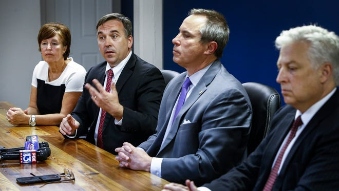 During a press conference, Germantown Municipal Schools' negotiating team members, left to right, School Board Chairman Linda Fisher, Superintendent Jason Manuel, Mayor Mike Palazzolo and City Administrator Patrick Lawton discuss their offer of $25 million to get three namesake schools, Germantown elementary, middle and high, back to the suburban district. The offer was made to Shelby County Schools Superintendent Dorsey Hopson and Chris Caldwell, the SCS board of education chairman.