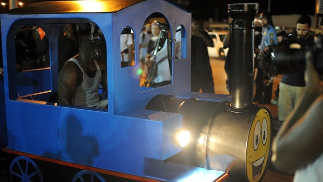 A protester drives a train trolly during a peaceful protest on West Florissant Ave. in Ferguson, Missouri on August 19, 2014.